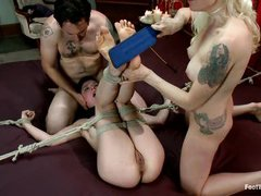 Парочка извращенцев наказывает свою молодую связанную рабыню